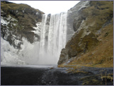 The waterfall at Skógafoss where Magnus looks for clues.